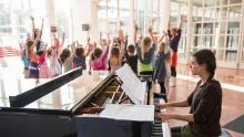 Children sing and dance in the foyer of Dutch National Opera & Ballet